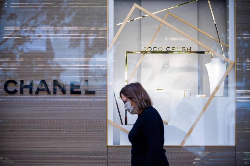 A pedestrian passes the Chanel SA flagship luxury goods store on Avenue Montaigne in Paris, France, on Wednesday, Aug. 12, 2020. As the capital of the world's No. 1 tourist destination, Paris has no shortage of hotels for all tastes and wallets, from the dumpy dive to the pillared palace, where a single night can set you back as much as 30,000 euros ($35,000). Photographer: Nathan Laine/Bloomberg
