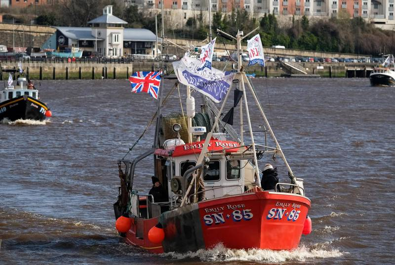 NEWCASTLE UPON TYNE, ENGLAND - MARCH 15: A flotilla of fishing boats from the Fishing For Leave protest group arrive at the Quayside area of the River Tyne on March 15, 2019 in Newcastle Upon Tyne, United Kingdom. Fishing for Leave are supporting other Pro-Brexit groups who are calling for the Government to scrap the Withdrawal Agreement and for MP's to ensure that Britain leaves the EU with no deal. The flotilla marks the official launch of the 'March to Leave' walk that begins the following day and will make its way to London in 14 stages arriving on March 29, the original date for the UK to leave the European Union. (Photo by Ian Forsyth/Getty Images)
