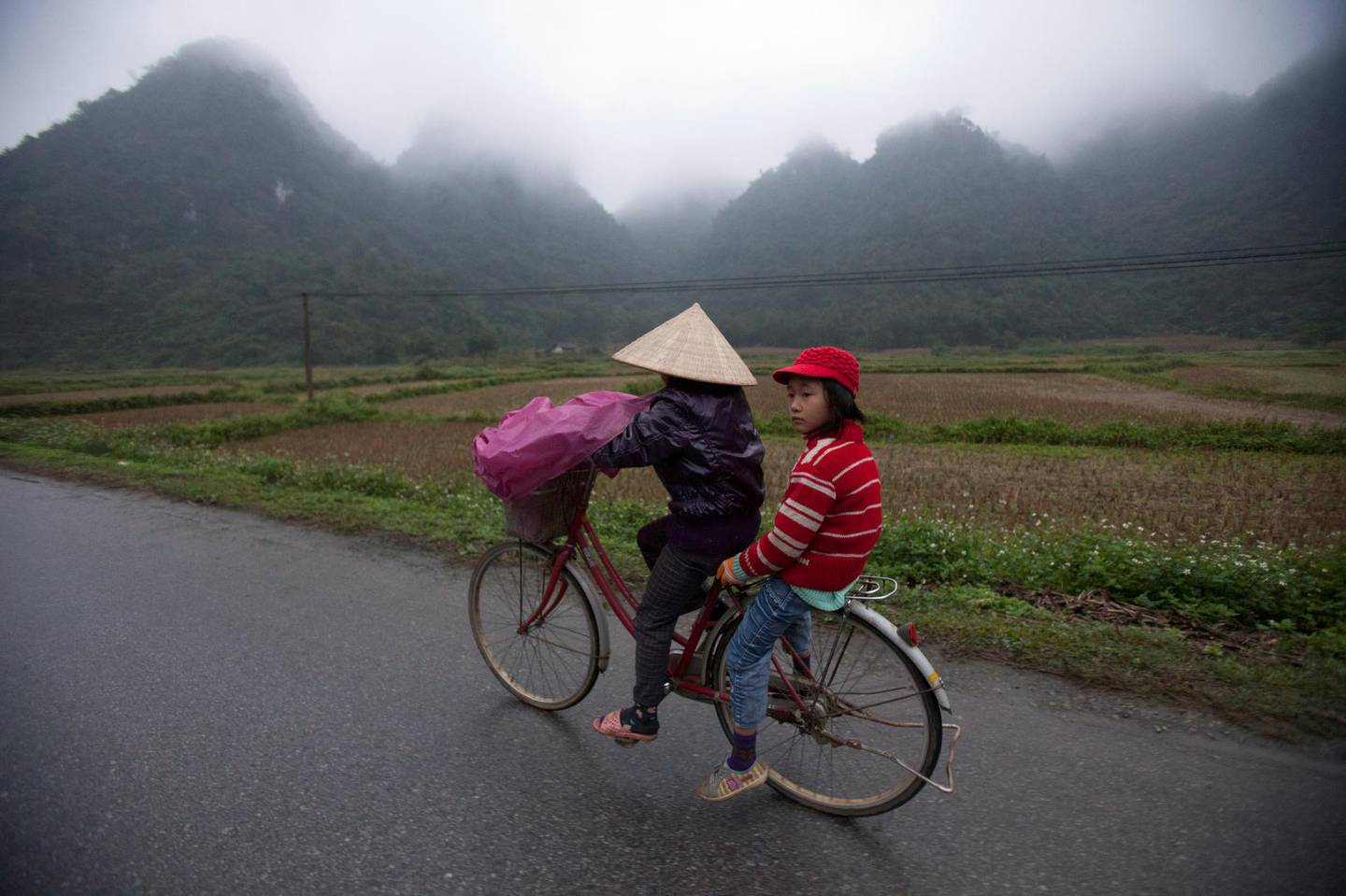BINH GIA, VIETNAM - 2012/12/28: Students going to school in Binh Gia, Lang Son which is about 160 kilometers north of Hanoi. The temperature is about 10 celcious degree.. (Photo by Chau Doan/LightRocket via Getty Images)