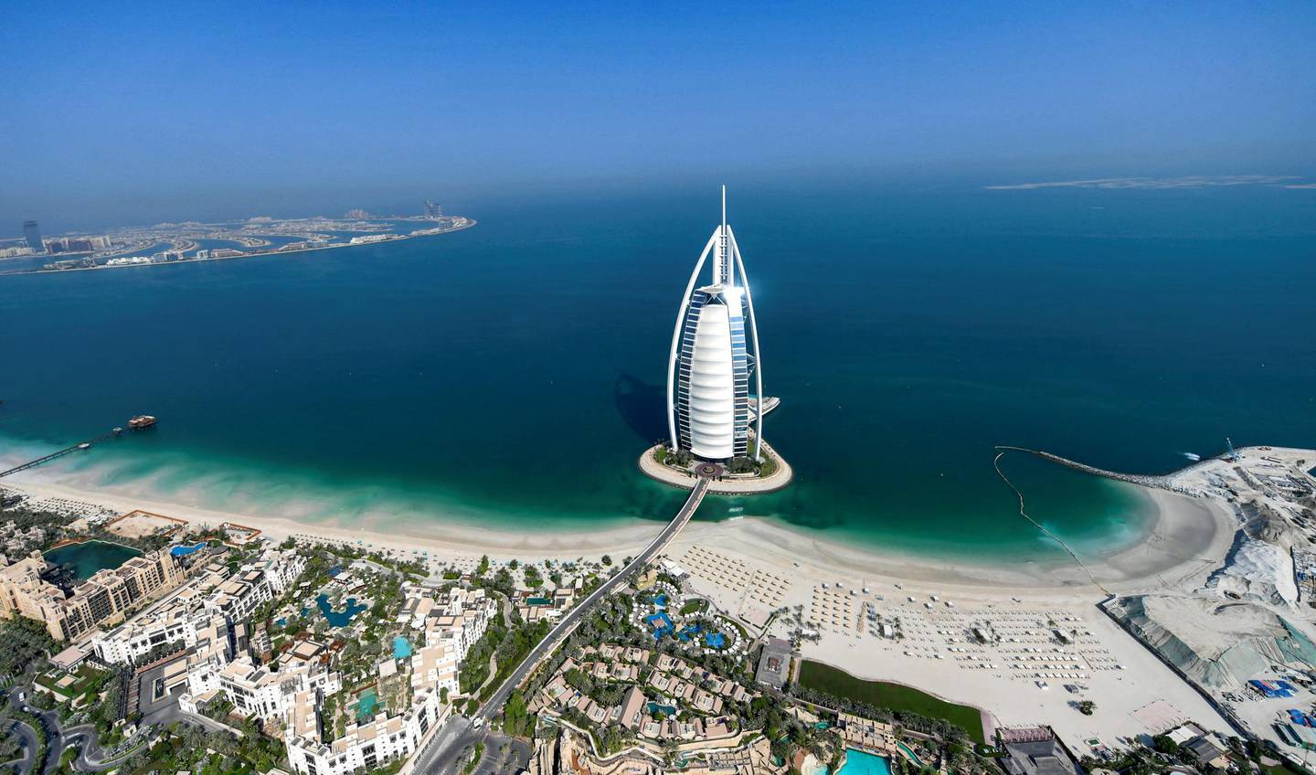 This picture taken on July 8, 2020 shows an aerial view of the Burj al-Arab hotel in the Gulf emirate of Dubai, during a government-organised helicopter tour. (Photo by KARIM SAHIB / AFP)