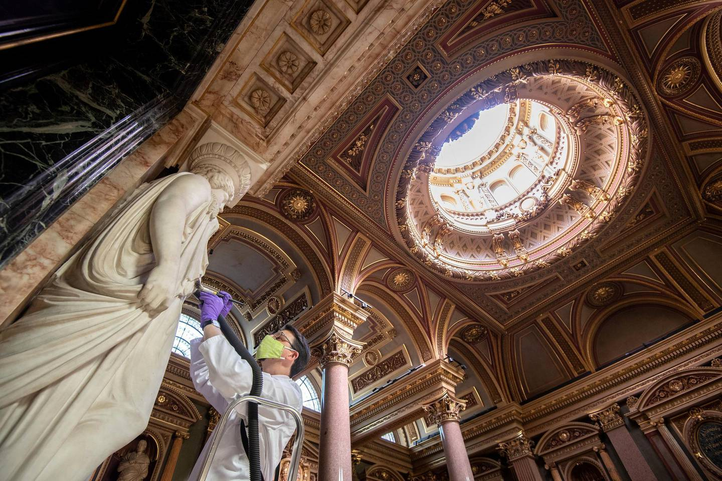 Conservator Edward Cheese cleans marble sculptures at the Fitzwilliam Museum in Cambridge as they make final preparations to reopen to the general public following the easing of lockdown restrictions in England. (Photo by Joe Giddens/PA Images via Getty Images)