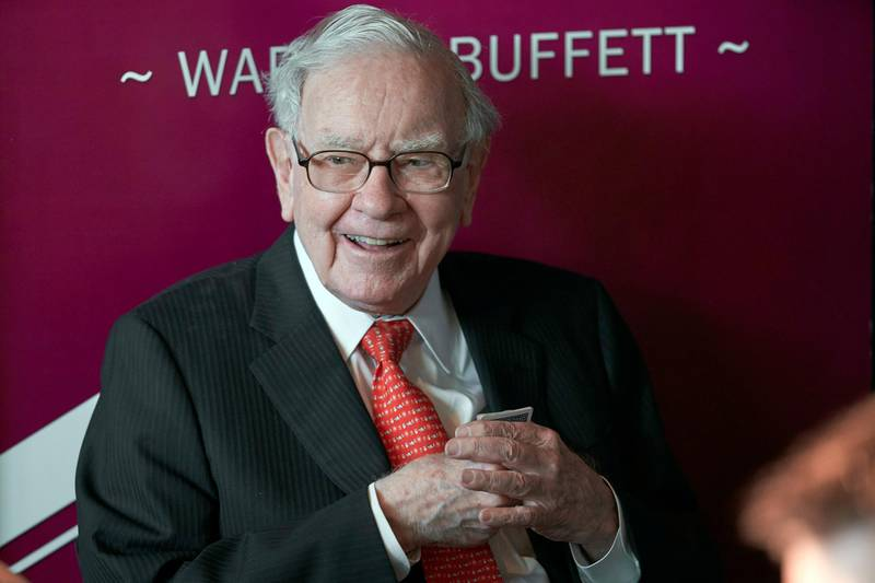FILE - In this May 5, 2019, file photo Warren Buffett, Chairman and CEO of Berkshire Hathaway, smiles as he plays bridge following the annual Berkshire Hathaway shareholders meeting in Omaha, Neb. Buffett's company has purchased another $400 million of Bank of America stock less than a week after buying roughly $800 million of the bank's stock. Berkshire Hathaway Inc. said Monday, July 27, 2020 it held 998 million Bank of America shares after the latest purchases, which represents roughly 11.5% of the bank's stock. (AP Photo/Nati Harnik, File)