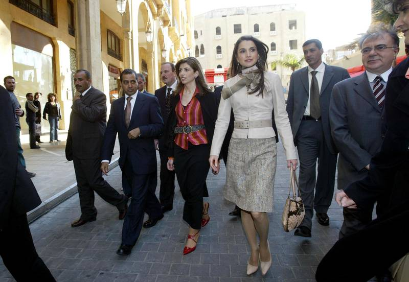 BEIRUT, LEBANON - MARCH 8:  Queen Rania of Jordan (3rd-R) during her visit to the Dar-al-Hayat and Laha Magazine while walking March 8, 2004 in Solidere, downtown Beirut, Lebanon. Arab first ladies are gathering in Beirut for the Arab Women's Summit to be held today and tomorrow.  (Photo by Salah Malkawi/Getty Images)