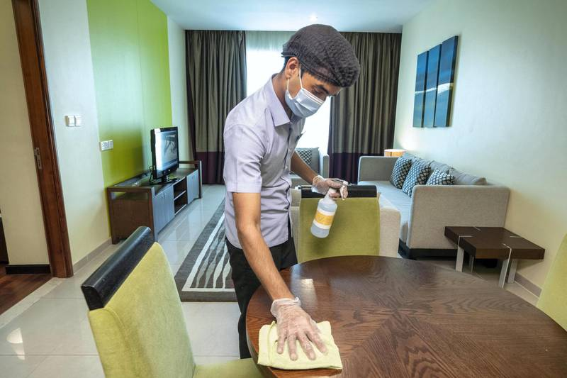 DUBAI, UNITED ARAB EMIRATES. 07 JULY 2020. COVID - 19 Measures in place at the Ramada by Wyndham Downtown Dubai. house Keeping staff go to great lengths to properly  clean and disinfect rooms, surfaces, items within the room and to fit sanitized clean sheets. (Photo: Antonie Robertson/The National) Journalist: None. Section: National.