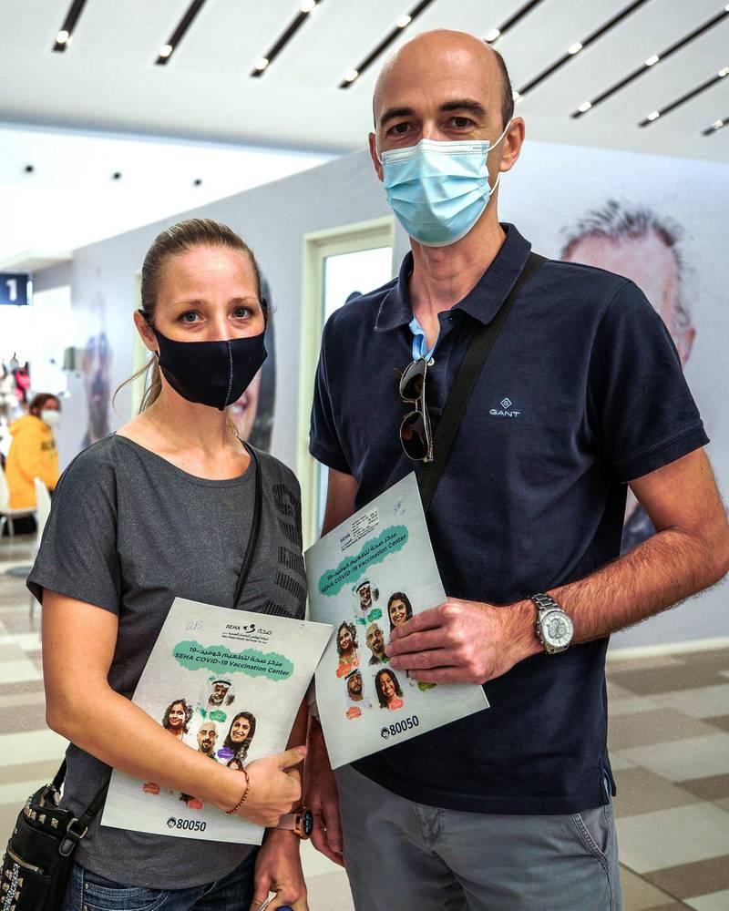 Abu Dhabi, United Arab Emirates, January 12, 2021. SEHA Vaccination Centre at the Abu Dhabi Cruise Terminal area.  Suzana and husband Novica Ristovic get vaccinated.Victor Besa/The NationalSection:  NAReporter:  Shireena Al Nowais