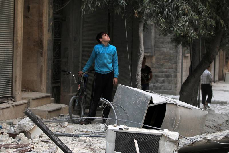 A youth inspects a damaged site after an airstrike in the besieged rebel-held al-Qaterji neighbourhood of Aleppo, Syria October 14, 2016. REUTERS/Abdalrhman Ismail