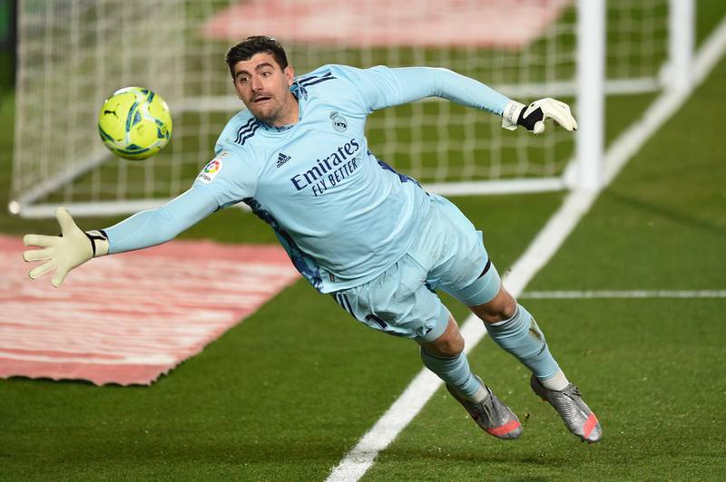 MADRID, SPAIN - DECEMBER 15: Thibaut Courtois of Real Madrid keeps the ball in play during the La Liga Santander match between Real Madrid and Athletic Club at Estadio Alfredo Di Stefano on December 15, 2020 in Madrid, Spain. Sporting stadiums around Spain remain under strict restrictions due to the Coronavirus Pandemic as Government social distancing laws prohibit fans inside venues resulting in games being played behind closed doors.  (Photo by Denis Doyle/Getty Images)