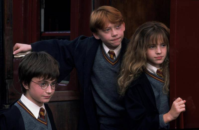 Daniel Radcliffe, Rupert Grint and Emma Watson in Harry Potter and the Philosopher's Stone. Courtesy Warner Bros. Pictures