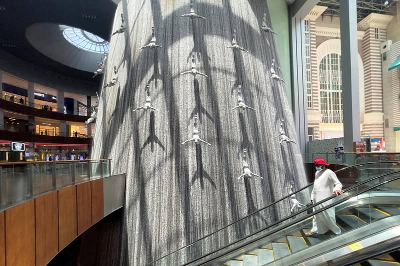 Shoppers walk through the Dubai Mall in Dubai, United Arab Emirates, June 11, 2021. Picture taken June 11, 2021. REUTERS/Christopher Pike