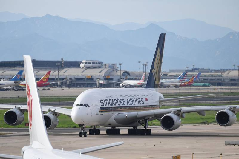 """A Singapore Airlines Airbus A380 taxis before take-off at Beijing airport on July 25, 2018.  Beijing hailed """"positive steps"""" as major US airlines and Hong Kong's flag carrier moved to comply on July 25 with its demand to list Taiwan as part of China, sparking anger on the island. A growing number of international airlines, including Qantas, Singapore Airlines, Qatar Airways, Emirates and KLM had already changed their websites from Taiwan to """"Taiwan, China"""", while others skirt the issue by merely listing cities. / AFP / GREG BAKER"""