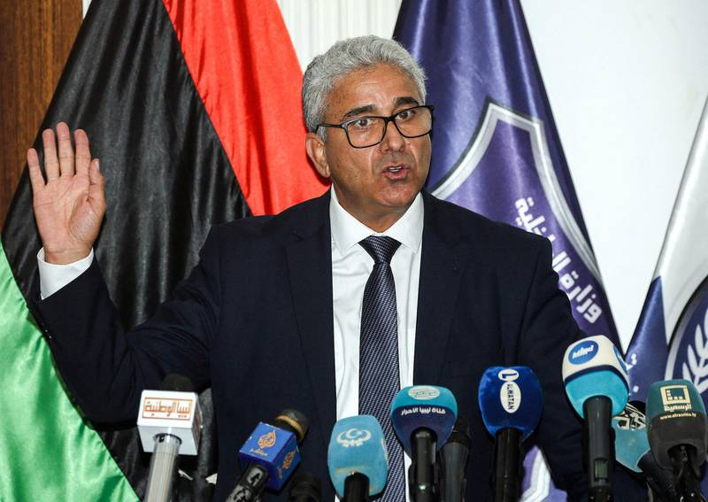 (FILES) A file photo taken on July 28, 2020 shows Fathi Bashagha, Interior Minister of Libya's UN-recognised Government of National Accord (GNA), addressing a press conference at the Tajura Training Institute, southeast of the GNA-held capital Tripoli. The powerful interior minister of Libya's unity government survived an assassination attempt on February 21, 2021 on a highway near the capital Tripoli, an official from his inner circle told AFP. / AFP / Mahmud TURKIA