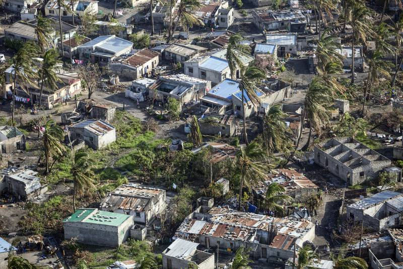 Debris and destroyed buildings from the cyclone stand in a residential neighbourhood in this aerial photograph over Beira, Mozambique, on Wednesday, March 27, 2019. Cyclone Idai hit the Mozambican coast earlier this month, devastating the port city of Beira and killing at least 700 people in Mozambique, Zimbabwe and Malawi. Photographer: Guillem Sartorio/Bloomberg