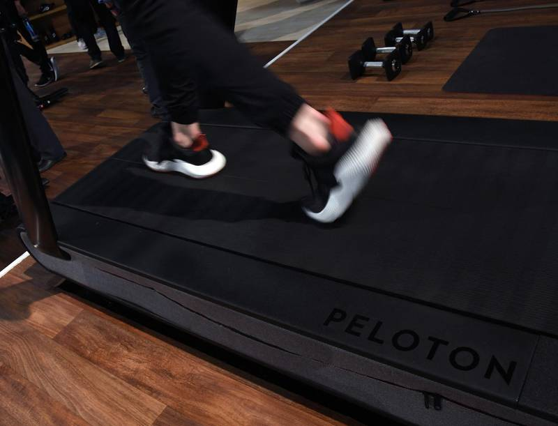 (FILES) In this file photo taken on January 10, 2018 a detail shot shows the running deck of a Peloton Tread treadmill during CES 2018 at the Las Vegas Convention Center  in Las Vegas, Nevada.  Exercise equipment maker Peloton on May 5, 2021 announced it had agreed with US safety regulators to recall some of its treadmills after multiple accidents, including one that killed a child, and apologized for not acting sooner. / AFP / GETTY IMAGES NORTH AMERICA / Ethan Miller