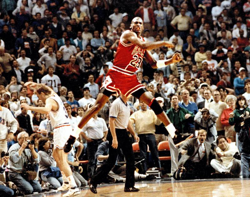 The Chicago Bulls' Michael Jordan reacts after hitting the game-winning basket over Cleveland's Craig Ehlo, left rear, in Game 5 of the NBA playoffs May 7, 1989, in Cleveland, Ohio.  (Ed Wagner Jr./Chicago Tribune/Tribune News Service via Getty Images)