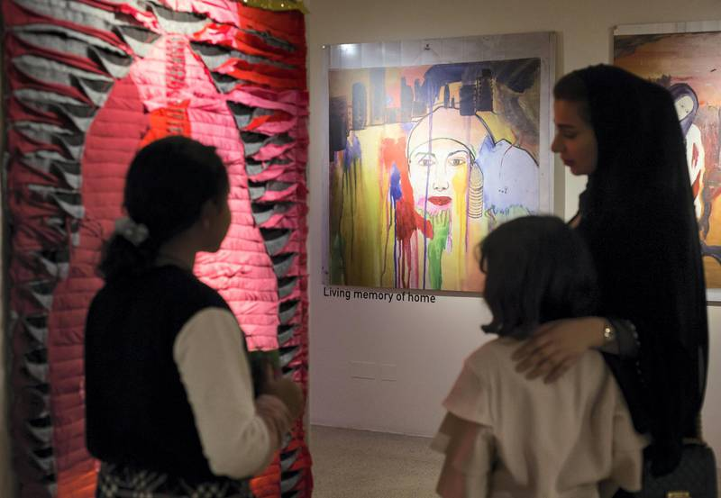 Sharjah, United Arab Emirates - Guests looking at Dr. Azra Aksamija's art at Sharjah Museum of Islamic Civilization.  Leslie Pableo for The National for Salam Al Amir's story