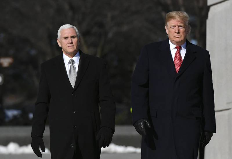 US President Donald Trump and US Vice President Mike Pence(L) visit the Martin Luther King Jr. Memorial in Washington, DC on Martin Luther King Day on January 21, 2019.  / AFP / MANDEL NGAN
