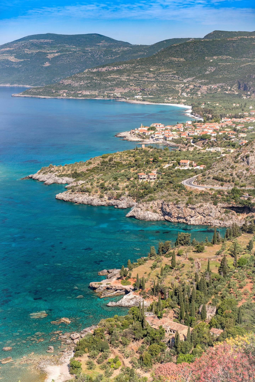 Kardamyli, Messenia, Peloponnese, Greece. Birdseye or elevated view of Kardamyli (transliterated as Kardamyle, Cardamyle, Kardamili, Kardhamili) is a village on the east coast of the Mani Peninsula on the aquamarine waters of the Messiniakos Gulf.