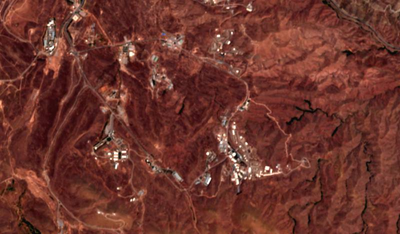 This June 21, 2020 photo from the European Commission's Sentinel-2 satellite shows a site before an explosion June 26, 2020, that rattled Iran's capital. Analysts say the blast came from an area in Tehran's eastern mountains they hides a underground tunnel system and missile production sites. (European Commission via AP)