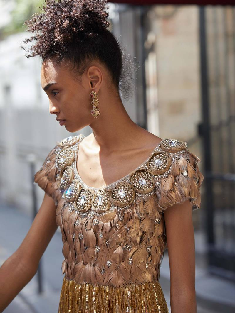 through the lens: Photography   Chantelle Dosser fashion director   Sarah MaiseyCorset dress with a top embroidered with hand-painted feathers and crystals, and a tulle skirt embroidered with sequins and fringes of canettes, Dolce & Gabbana Alta Moda. Gold filigree earrings, Dolce & Gabbana Alta Gioielleria
