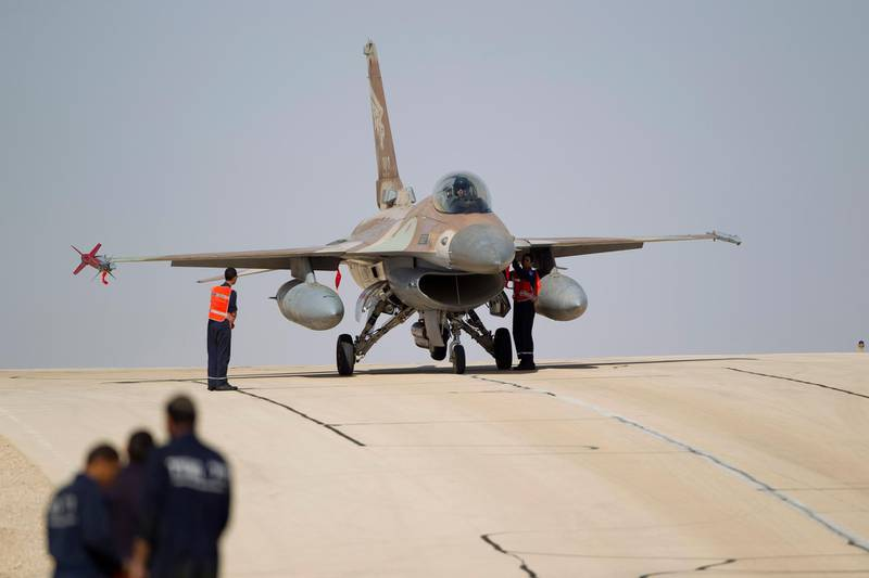 FILE - In this Monday, Nov 25, 2013, file photo, technicians inspect an Israeli air force F-16 jet at the Ovda airbase near Eilat, southern Israel. The Israeli military says it has shot down an Iranian drone that infiltrated the country and has struck Iranian targets in Syria that launched it. The military says that as part of the unusual event one of its F-16 jets crashed in northern Israel. (AP Photo/Ariel Schalit, File)