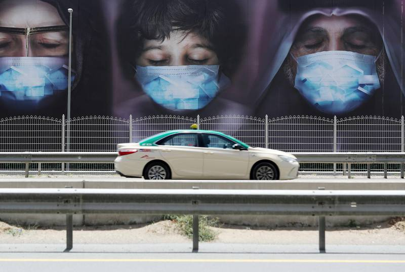 Dubai, United Arab Emirates - Reporter: N/A: A poster on Sheikh Zayed Road shows a family wearing facemasks tell people to Stay at home. Tuesday, April 14th, 2020. Dubai. Chris Whiteoak / The National