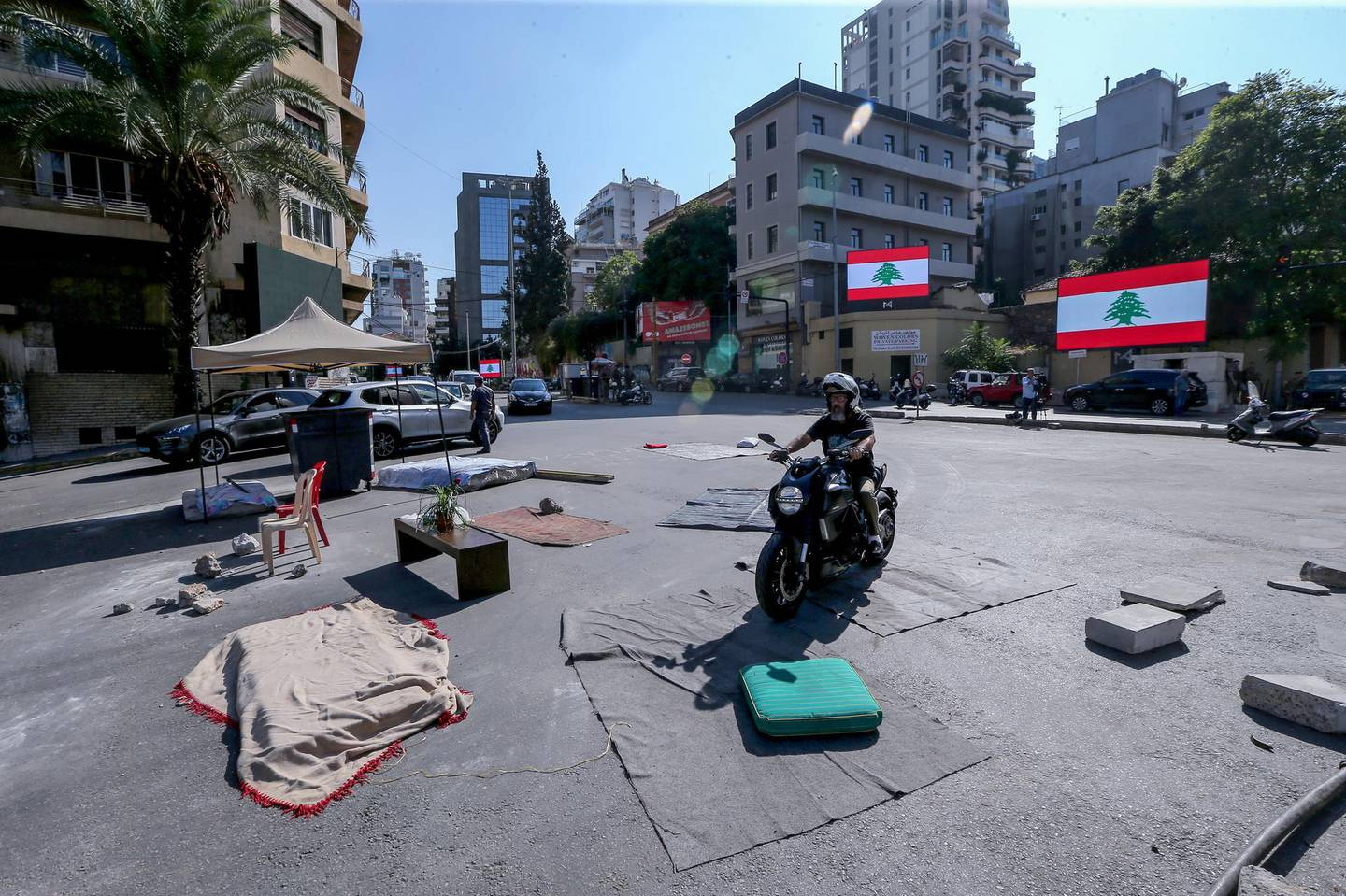 epa07959659 Anti-government protestors remove their tents from the main highway leading to east Beirut, Lebanon, 30 October 2019. Lebanese people started to clear streets in numerous areas as they grant time to the Lebanese President and Parliement to form a new government; and will continue protest in the main squares in all the Lebanese provinces in the second week of demonstrations against proposed tax hikes, and state corruption.  EPA/NABIL MOUNZER