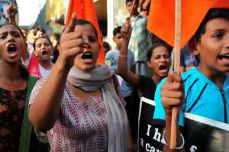 Members of the Bharatiya Janata Party students wing shout slogans during an anti-Maoist rebels and anti-goverment protest in Mumbai on May 30, 2010. Rescue workers completed search operations on May 30 after pulling out 146 bodies from the site of a train wreck in northeast India blamed on Maoist rebels. If confirmed as a Maoist strike, the May 28 derailment of a Kolkata-Mumbai express train would be the deadliest attack by the rebels in recent memory. The government has recently been severely criticised for its handling of the worsening left-wing insurgency. AFP PHOTO Sajjad HUSSAIN *** Local Caption ***  642783-01-08.jpg