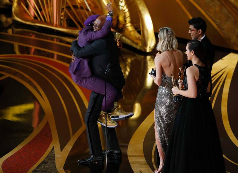 """91st Academy Awards - Oscars Show - Hollywood, Los Angeles, California, U.S., February 24, 2019. Spike Lee celebrates onstage with Samuel L. Jackson as he receives the Best Adapted Screenplay award for """"BlacKkKlansman"""". REUTERS/Mike Blake"""