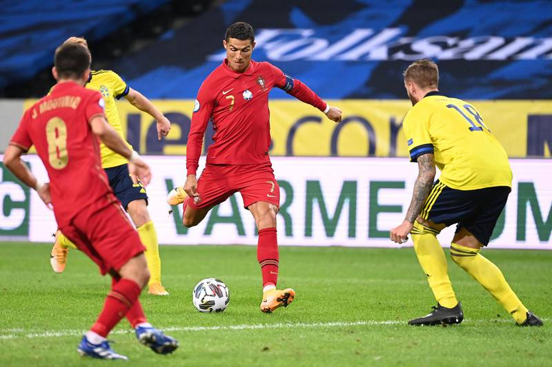 Portugal's forward Cristiano Ronaldo shoots to score his second goal during the UEFA Nations League football match between Sweden and Portugal on September 8, 2020 in Solna, Sweden. (Photo by Jonathan NACKSTRAND / AFP)