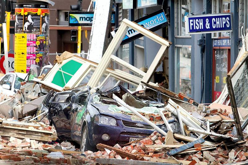February 24, 2011 of cars crushed under fallen rubble on Manchester Street two days after a deadly 6.3 magnitude earthquake in Christchurch. AFP