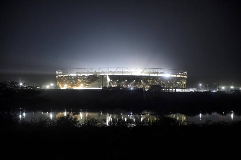 Motera Cricket Stadium, also known as Sardar Patel Stadium, is reflected on the surface of Sabarmati River on the outskirts of Ahmedabad on February 15, 2020, ahead of the visit of US President Donald Trump and his wife Melania in Ahmedabad. (Photo by SAM PANTHAKY / AFP)