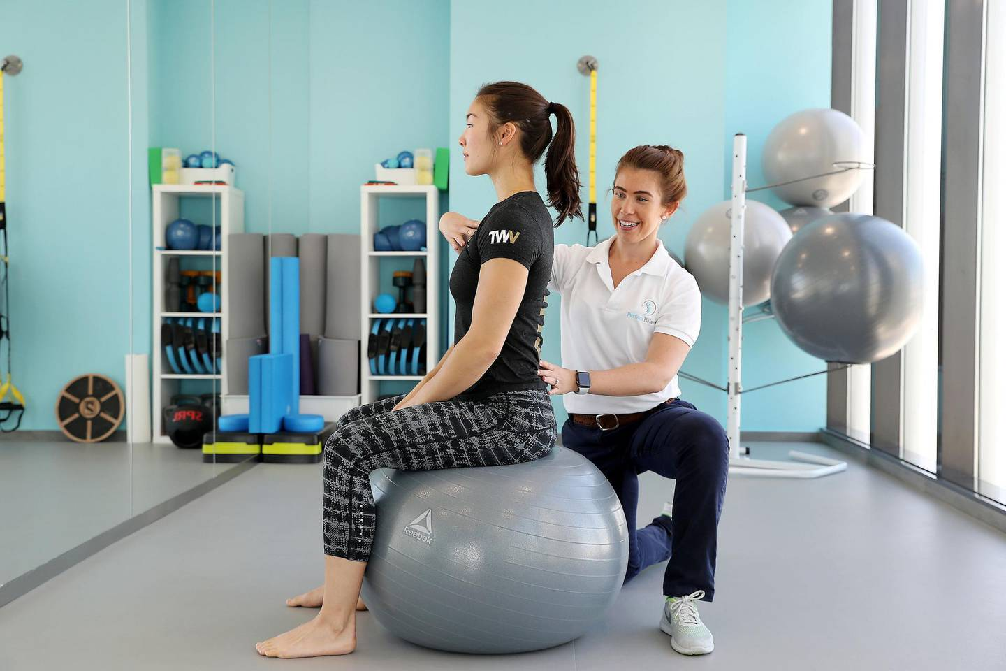 ABU DHABI , UNITED ARAB EMIRATES , MARCH 22  – 2018 :- Amy Gilbert , physio and owner of PerfectBalance teaching a right posture to her client at Tamouh Towers in Marina Square in Abu Dhabi. ( Pawan Singh / The National ) Story by Ann Marie