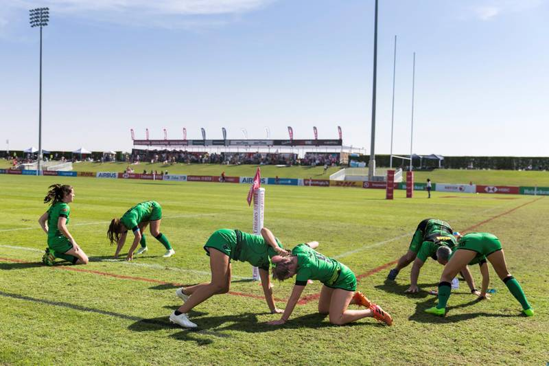DUBAI, UNITED ARAB EMIRATES - DECEMBER 1, 2018.   Dubai Eagles teammates warm up before their match on the final day of this year's Dubai Rugby Sevens.  (Photo by Reem Mohammed/The National)  Reporter:  Section:  NA POAN