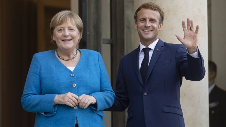 An image that illustrates this article Macron and Merkel meet in Paris to discuss world's crises and EU issues