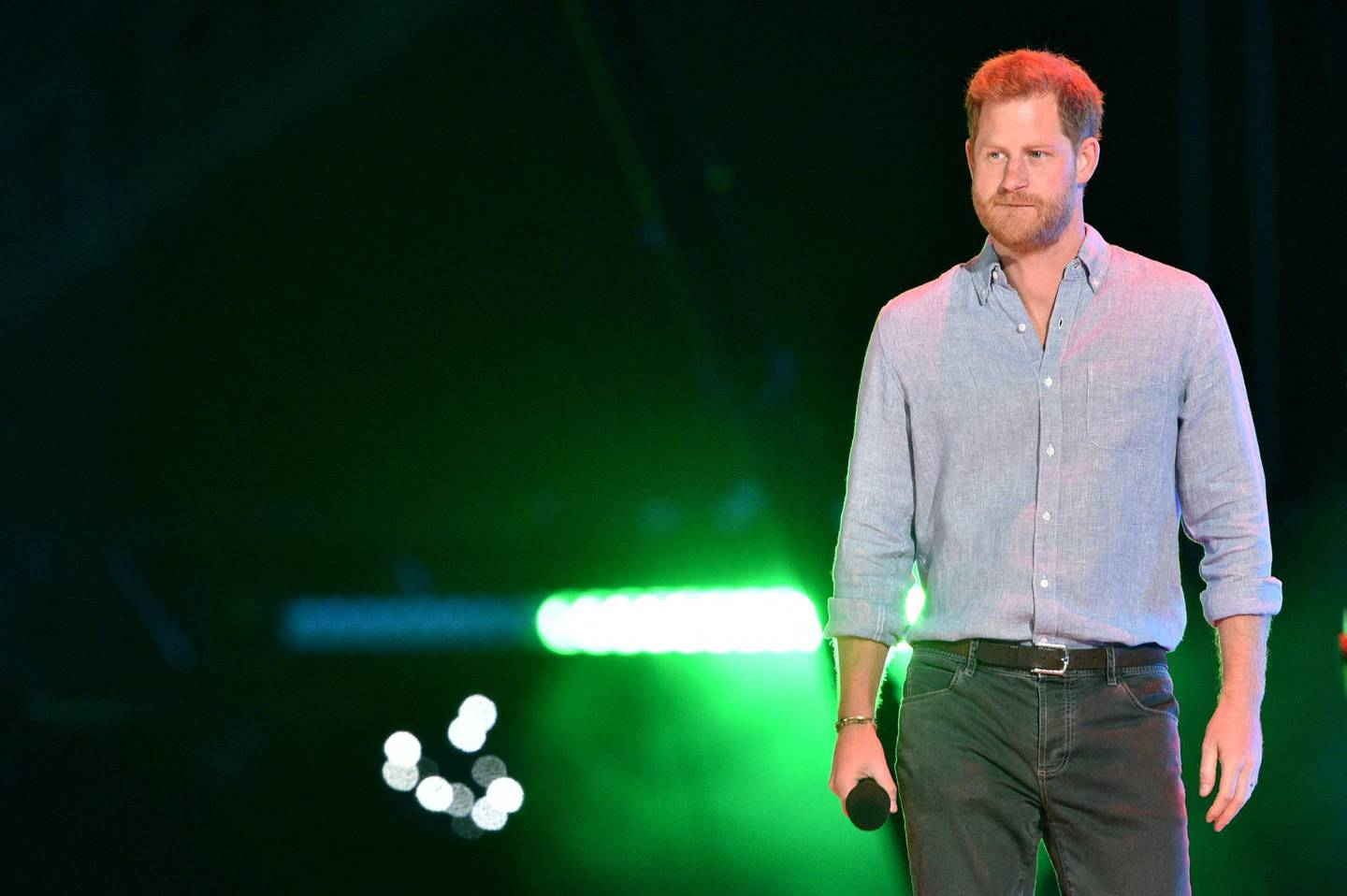 """(FILES) In this file photo taken on May 02, 2021 Co-Chair Britain's Prince Harry, Duke of Sussex, arrives onstage to speak during the taping of the """"Vax Live"""" fundraising concert at SoFi Stadium in Inglewood, California. In a new documentary series set for release May 21, 2021 Prince Harry is once again emphasizing that his family turned a blind eye to the struggles of his wife Meghan Markle, saying he will """"never be bullied into silence."""" / AFP / VALERIE MACON"""
