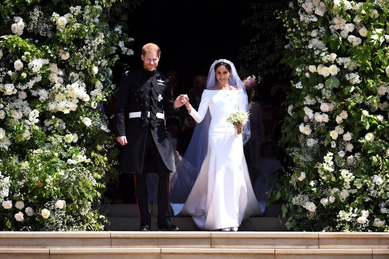 FILE PHOTO: Prince Harry and Meghan Markle leave St George's Chapel at Windsor Castle after their wedding.  Saturday May 19, 2018.  Neil Hall/Pool via REUTERS/File Photo