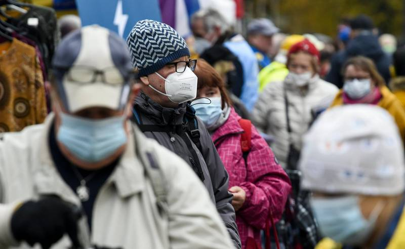 Citizens wear face masks at the Hakaniemi Sunday market in Helsinki, Finland, on Sunday Nov. 1, 2020. People continue their lives with Sunday markets although face masks have become more popular to protect against the coronavirus. (Markku Ulander/Lehtikuva via AP)