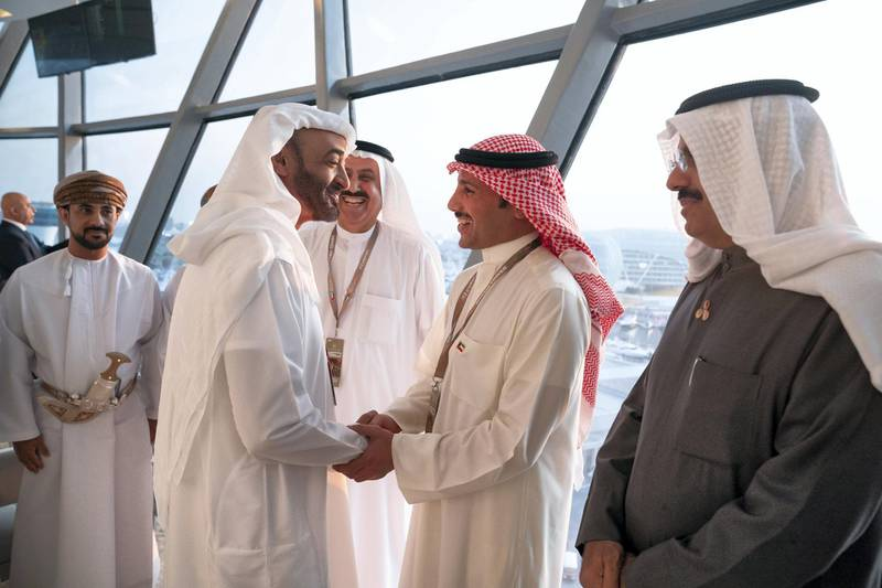 YAS ISLAND, ABU DHABI, UNITED ARAB EMIRATES - December 01, 2019: HH Sheikh Mohamed bin Zayed Al Nahyan, Crown Prince of Abu Dhabi and Deputy Supreme Commander of the UAE Armed Forces (L), greets HE Marzouq Al Ghanim, Speaker of the Kuwait National Assembly (2nd R), at Shams Tower during the Formula 1 2019 Etihad Airways Abu Dhabi Grand Prix at Yas Marina Circuit. Seen with HH Sheikh Ahmad Nawaf Al-Ahmad Al-Sabah, Governor of Hawally, Kuwait (R) and HE Saqr bin Ghobash Saeed Ghobash, Chairman of the UAE Federal National Council (FNC) (3rd R).  ( Hamad Al Kaabi  / Ministry of Presidential Affairs ) ---