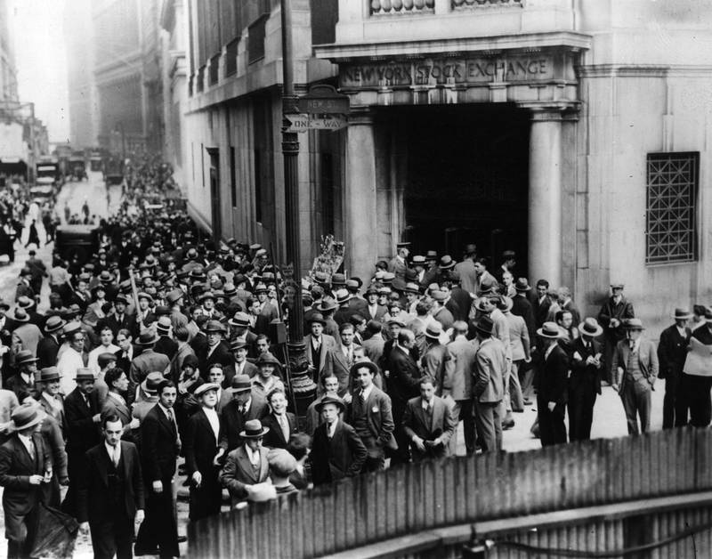The crowds on Wall Street, New York, after the stock exchange crashed.   (Photo by Fox Photos/Getty Images)