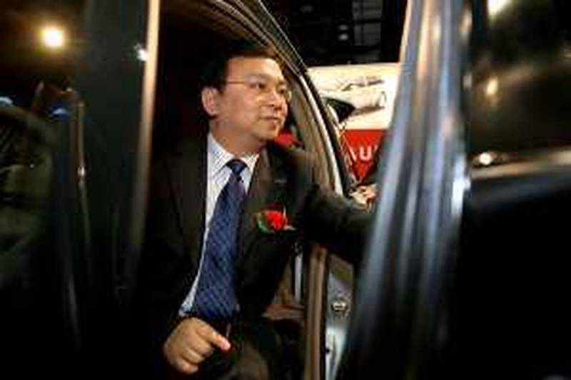 Wang Chuanfu, chairman and president of BYD Co., sits for photos in a BYD vehicle at the 2009 North American International Auto Show (NAIAS) in Detroit, Michigan, U.S., on Monday, Jan. 12, 2009. BYD Co., the Chinese automaker backed by billionaire investor Warren Buffett, plans to bring electric autos to the U.S. in 2011. Photographer: Fabrizio Costantini/Bloomberg News