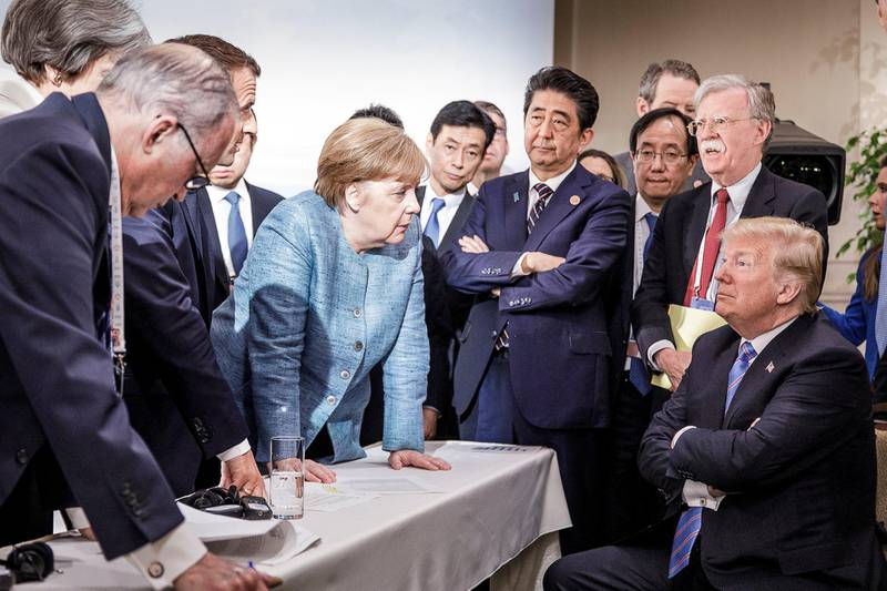German Chancellor Angela Merkel speaks to U.S. President Donald Trump during the second day of the G7 meeting in Charlevoix city of La Malbaie, Quebec, Canada, June 9, 2018. Bundesregierung/Jesco Denzel/Handout via REUTERS  ATTENTION EDITORS - THIS IMAGE WAS PROVIDED BY A THIRD PARTY. NO RESALES. NO ARCHIVES.