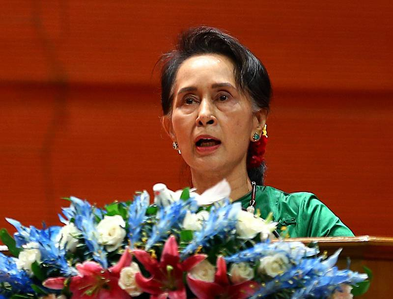 FILE - In this July 16, 2018, file photo, Myanmar's Leader Aung San Suu Kyi speaks during the closing ceremony of the third session of the 21st Century Panglong Union Peace Conference at Myanmar International Convention Centre in Naypyitaw, Myanmar. Myanmar on Thursday, Aug. 9, 2018, sharply rejected an attempt by the International Criminal Court to consider the country's culpability for activities that caused about 700,000 minority Rohingya Muslims to flee to Bangladesh for safety. The office of Suu Kyi said in a statement posted online that the court in the Netherlands has no jurisdiction over Myanmar because it is not a member state. (AP Photo/Aung Shine Oo)