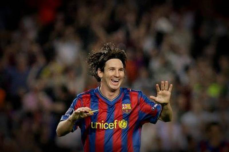 Barcelona's Argentinian forward Lionel Messi celebrates after scoring during the UEFA Champions League football match between Barcelona and Dynamo Kiev at the Camp Nou stadium in Barcelona on September 29, 2009. AFP PHOTO/JOSEP LAGO.