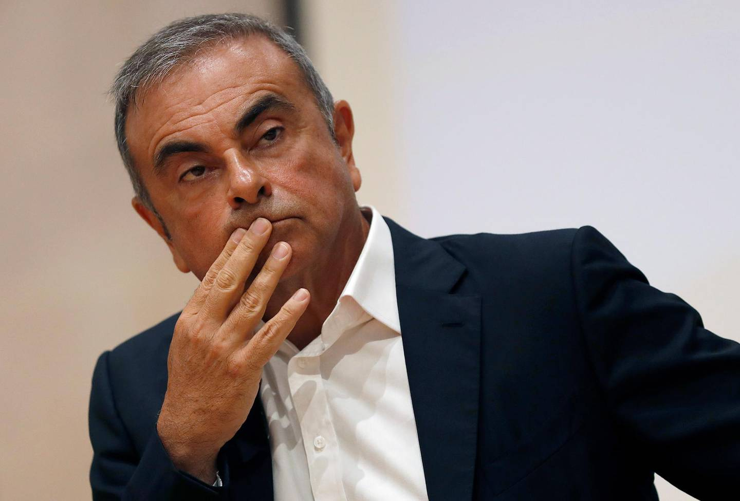 """FILE - In this Sept. 29, 2020, file photo, former Nissan Motor Co. Chairman Carlos Ghosn holds a press conference at the Maronite Christian Holy Spirit University of Kaslik, as he launches an initiative to help Lebanon that is undergoing a severe economic and financial crisis, in Kaslik, north of Beirut, Lebanon. Former Nissan Chief Executive Hiroto Saikawa told a Japanese court Wednesday, Feb. 24, 2021, he believed the compensation for his predecessor Carlos Ghosn was too low """"by international standards,"""" and so he supported Ghosn's retirement packages to prevent him from leaving.  (AP Photo/Hussein Malla, File)"""