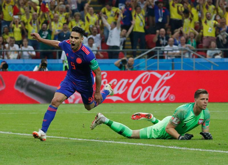 epa06837583 Radamel Falcao (L) of Colombia celebrates after scoring the 0-2 goal during the FIFA World Cup 2018 group H preliminary round soccer match between Poland and Colombia in Kazan, Russia, 24 June 2018.  (RESTRICTIONS APPLY: Editorial Use Only, not used in association with any commercial entity - Images must not be used in any form of alert service or push service of any kind including via mobile alert services, downloads to mobile devices or MMS messaging - Images must appear as still images and must not emulate match action video footage - No alteration is made to, and no text or image is superimposed over, any published image which: (a) intentionally obscures or removes a sponsor identification image; or (b) adds or overlays the commercial identification of any third party which is not officially associated with the FIFA World Cup)  EPA/ROBERT GHEMENT   EDITORIAL USE ONLY