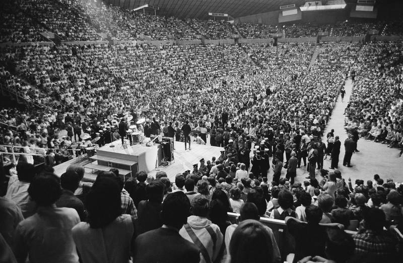 The Beatles perform at the Seattle Centre Coliseum in Seattle, Washington, during their US tour, 24th August 1964. (Photo by William Lovelace/Express/Getty Images)