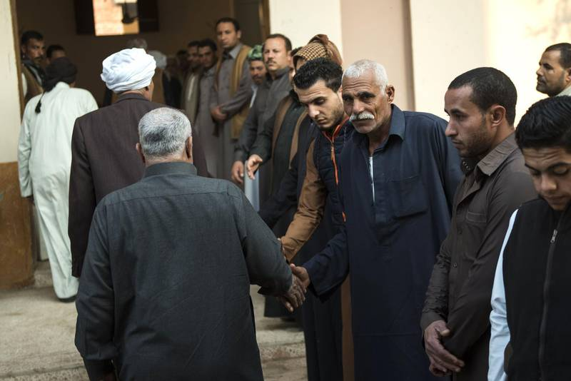 Egyptians attend on November 26, 2017 in the village of Saud, in the centre of al-Husseiniya in the country's northern province of al-Sharqiya, the funeral of Fethy Ismail, the Muadhin of al-Rawda mosque, who died in an attack by militants near the North Sinai provincial capital of El-Arish. Earlier in the week armed attackers killed over 300 worshippers in a bomb and gun assault on the packed mosque in Egypt's restive North Sinai province, in the deadliest attack the country has witnessed. / AFP PHOTO / MOHAMED EL-SHAHED