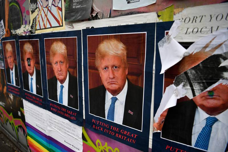 epa07745610 Artist STOT21stcplanB's work 'Boris Borump' which depicts both US President Donald Trump and British Prime Minister Boris Johnson is displayed on a wall in east London, Britain 28 July 2019. Boris Johnson defeated Jeremy Hunt to become the new British Prime Minister.  EPA/NEIL HALL