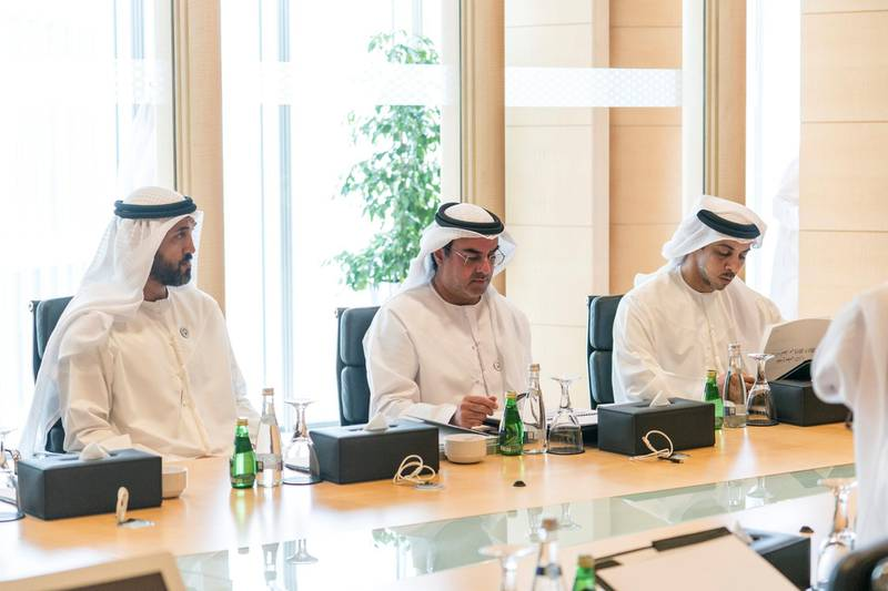 ABU DHABI, UNITED ARAB EMIRATES -  March 07, 2018: (L-R) HE Mohamed Mubarak Al Mazrouei, Undersecretary of the Crown Prince Court of Abu Dhabi, HH Sheikh Mohamed bin Khalifa Al Nahyan, Abu Dhabi Executive Council Member, and HH Sheikh Mansour bin Zayed Al Nahyan, UAE Deputy Prime Minister and Minister of Presidential Affairs, attend a board meeting at the Abu Dhabi Investment Authority (ADIA).  ( Ryan Carter for the Crown Prince Court - Abu Dhabi ) ---