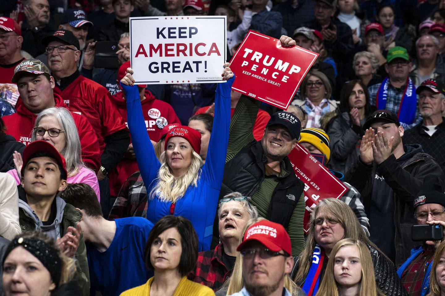 """TOLEDO, OH - JANUARY 09: Supporters cheer in the crowd as President Donald Trump speaks at a """"Keep America Great"""" campaign rally at the Huntington Center on January 9, 2020 in Toledo, Ohio. President Trump won the swing state of Ohio in 2016 by eight points over his opponent Hillary Clinton.   Brittany Greeson/Getty Images/AFP == FOR NEWSPAPERS, INTERNET, TELCOS & TELEVISION USE ONLY =="""
